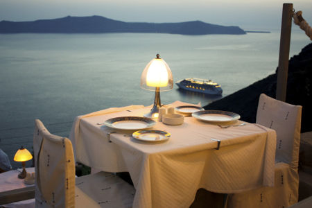 A table in a restaurant in front of the beautiful sea