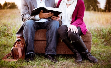 couple reading in a park